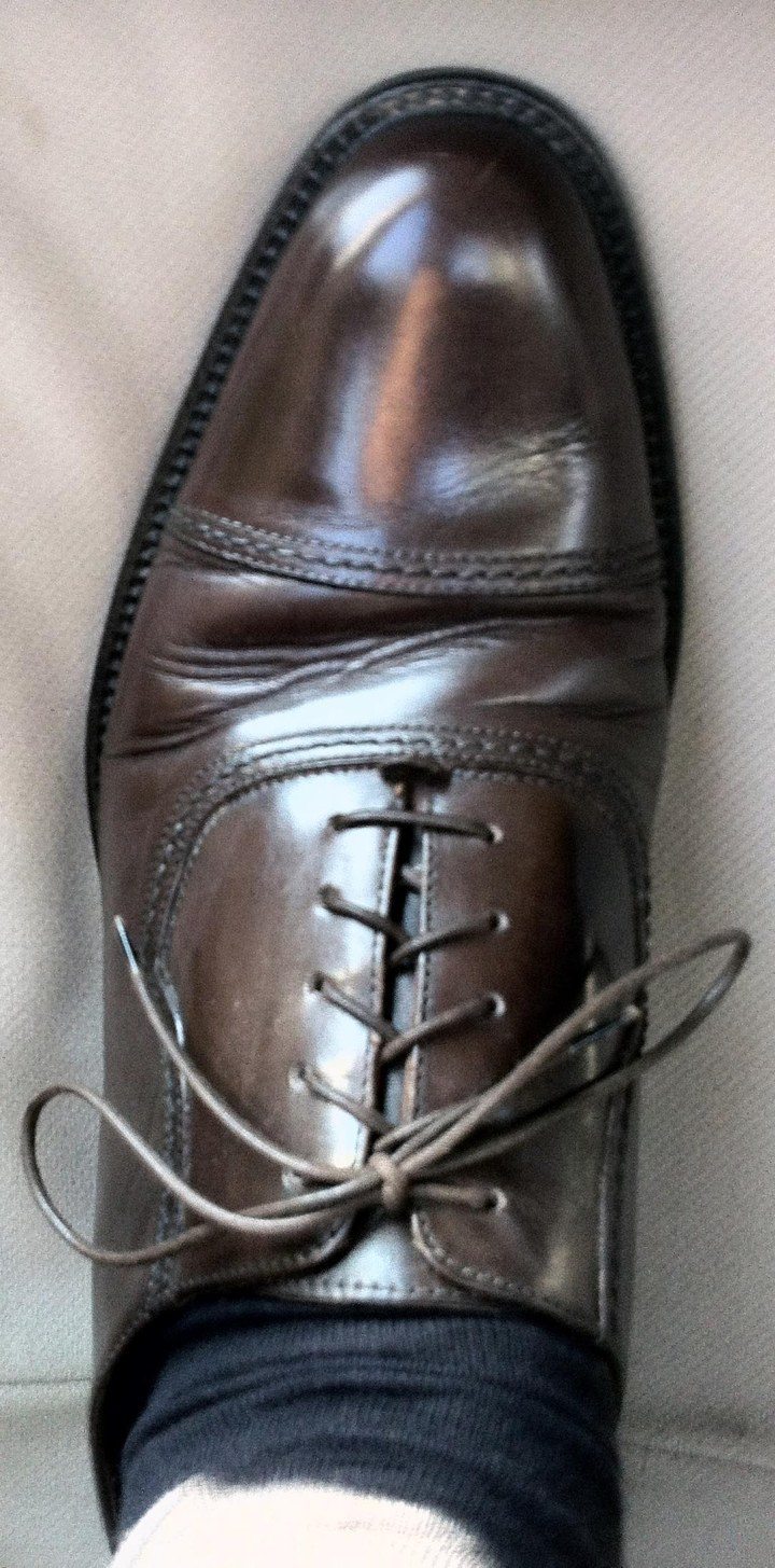 Dark brown cap-toed oxford shoe