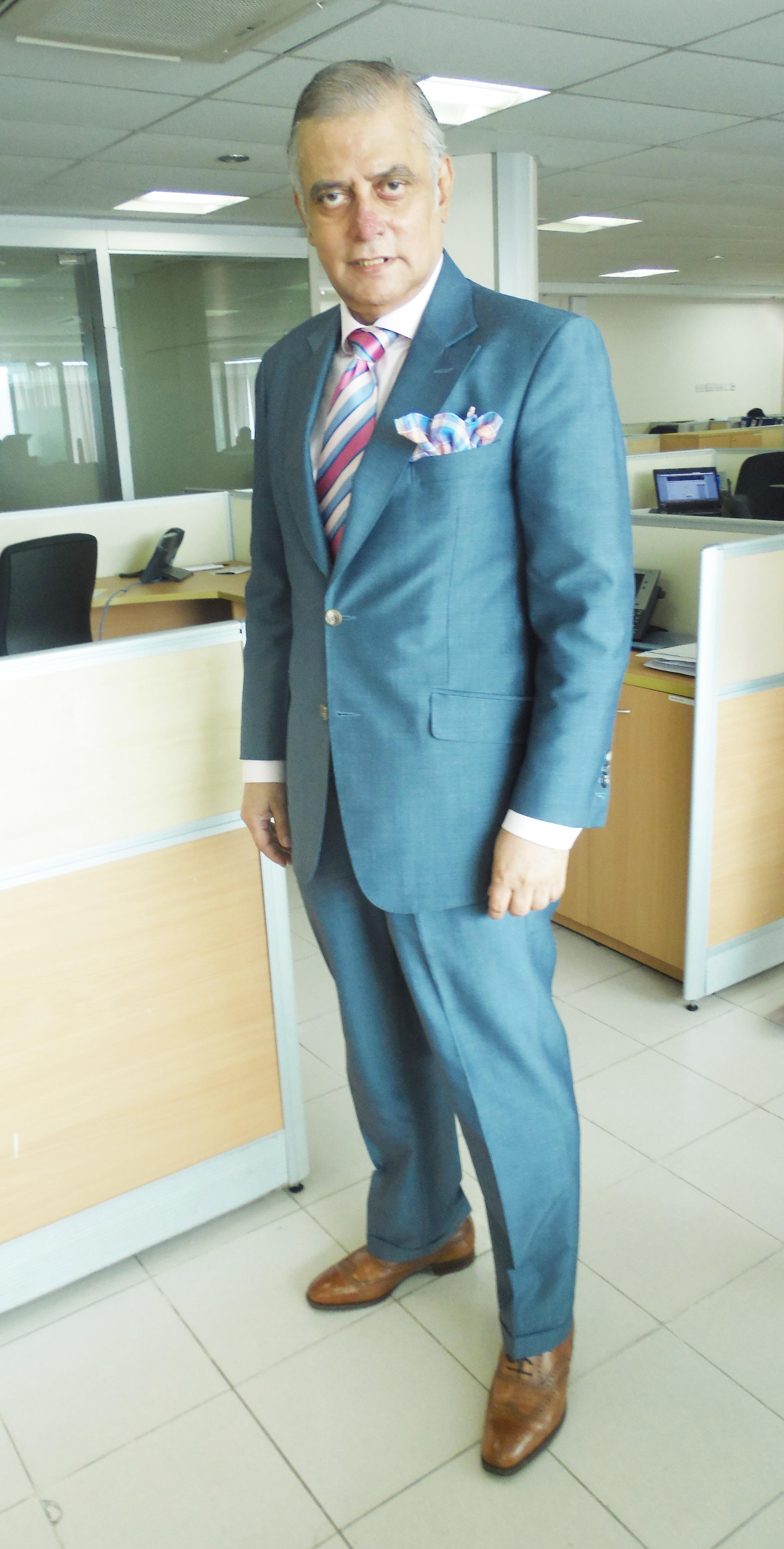 Q. I own a navy-blue suit with which I wear tan shoes. Recently, a woman in the office advised me that a gentleman only wears brown shoes at the weekend.