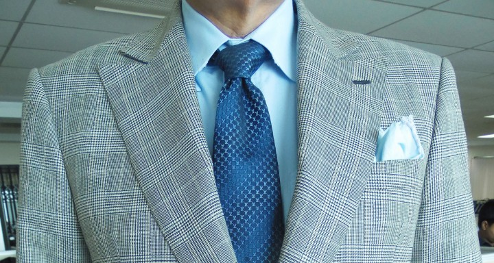Gray PoW suit, light blue shirt, blue silk tie, light blue linen pocket square