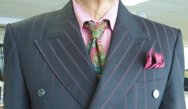 Purple gray suit, red check shirt, Green and maroon paisley silk tie, peach silk pocket square