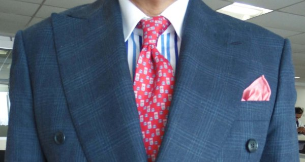 Blue check suit, pink silk tie, pink linen pocket square