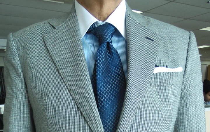 light gray suit, blue candy stripe contrast collar shirt, blue silk tie, white linen pocket square