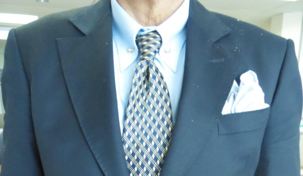Blue suit, white shirt, white and blue check silk tie, light blue linen pocket square