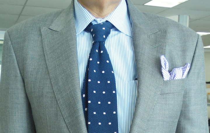 Gray suit, blue stripe shirt, blue silk knit tie with white dots, blue check linen pocket square