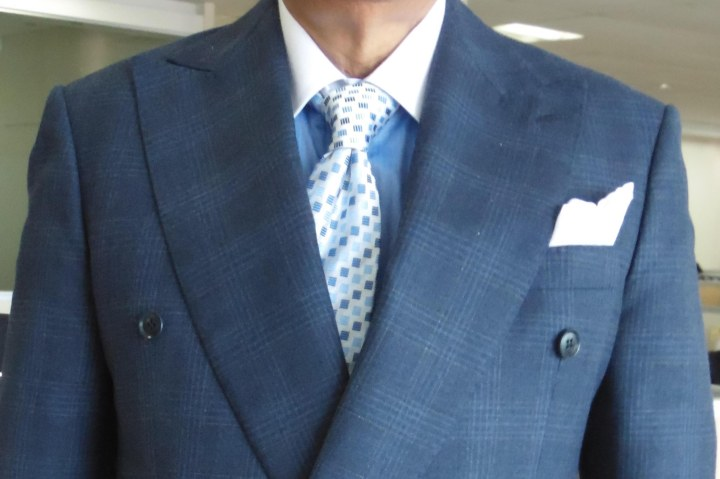 blue check suit, blue contrast collar shirt, blue and white patterned silk tie, and white linen pocket square