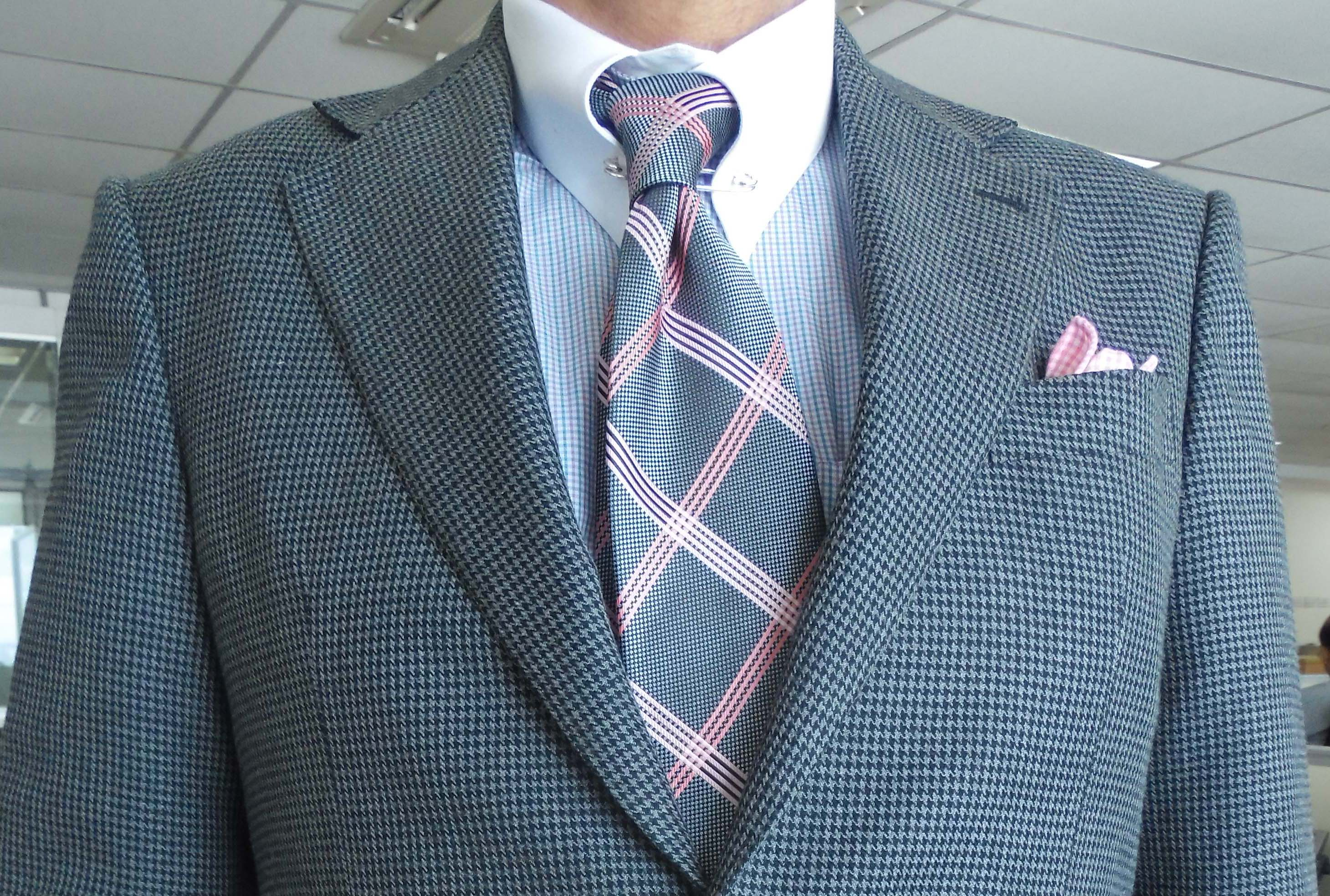 fde7efd1f39c7 ... pocket square Gray hounds tooth suit, gray and pink check silk tie, pink  and blue silk