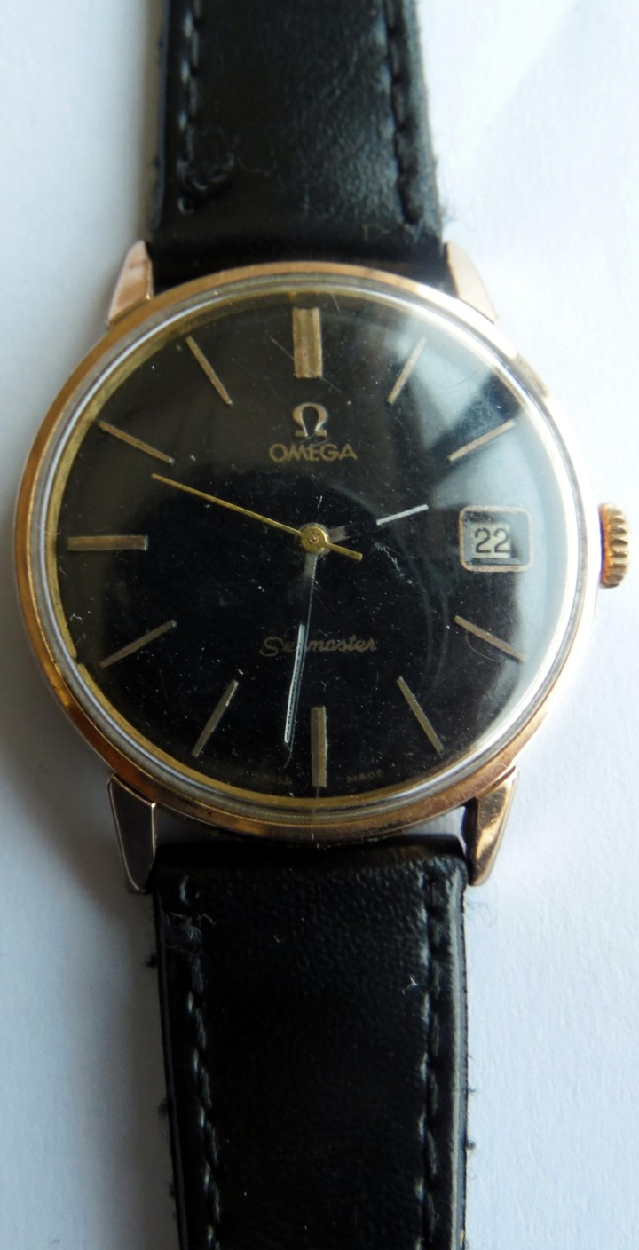 Omega Seamaster date gold plted manual winding black leather strap